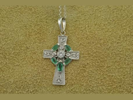 Custom Celtic Cross - 14KWG Celtic Cross holding Emeralds and Diamonds.  Cross was designed to accomodate the customers stones.