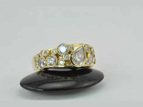 "Custom Remount - 14KYG Ladies Diamond remount ring.  This ring was designed to take full advantage of the customer numerous odd sized diamonds.  The ""Bubble Effect"" made this ring look stunning!"