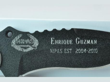 Custom Engraving - Custom Engraving on a Knife presented to a retiring Police Officer.