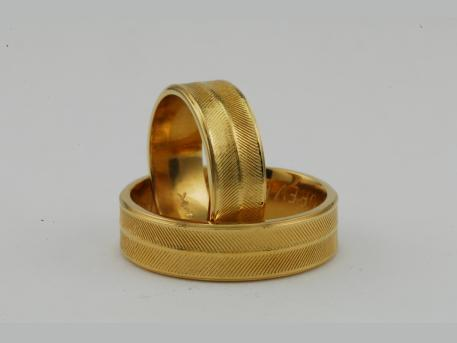 Custom Wedding Bands - 14KYG Custom Wedding Bands.  These were a remake of their original wedding bands that had worn out.  These will last a life time!